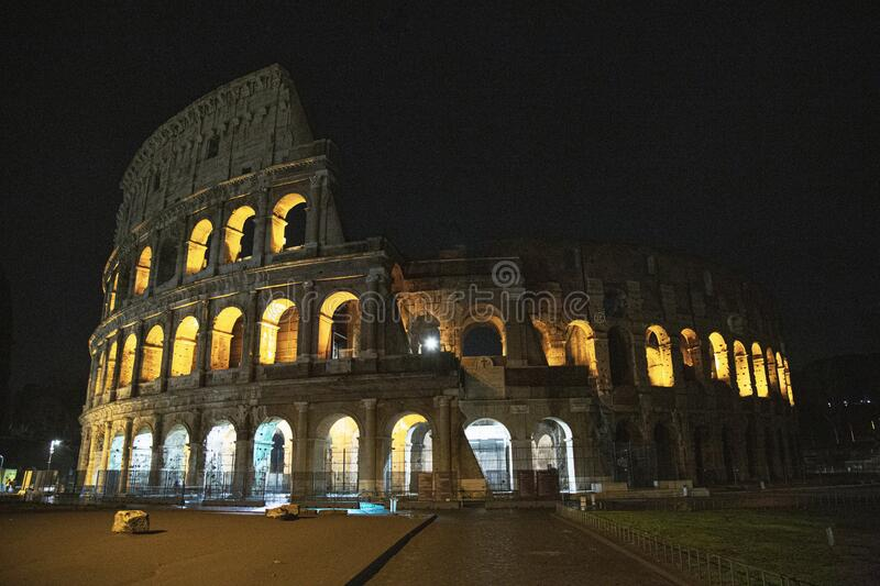 Colosseum by night, Rome, Italy. The Colosseum also known as the The Flavian Amphitheatre illumintated at night. The Colosseum or the Flavian Amphitheatre is an royalty free stock images