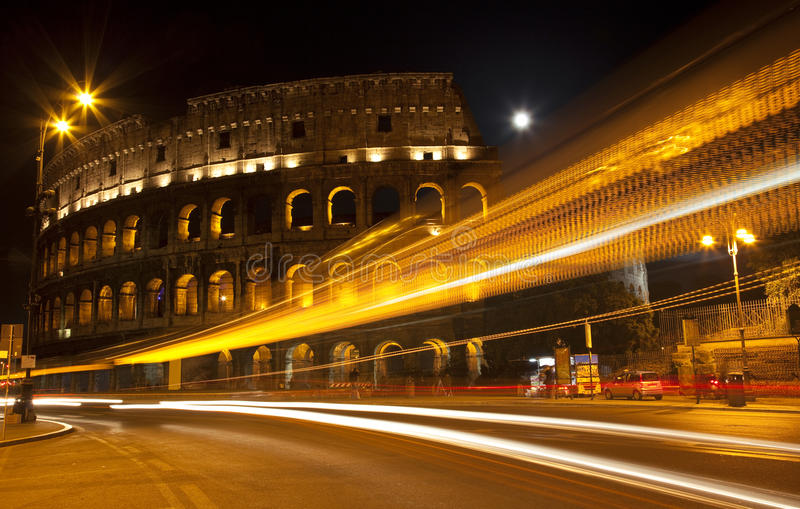 Colosseum Street Abstract Night Moon Rome Italy. Colosseum Modern Street Abstract Night Moon Time Lapse Rome Italy Built by Vespacian royalty free stock photography