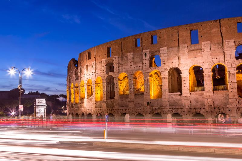 Colosseum at twilight with light trails in Rome, Italy.  royalty free stock photos