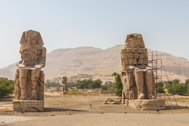 Two massive stone statues Colossi of Memnon Thebes, Luxor, Egypt royalty free stock image