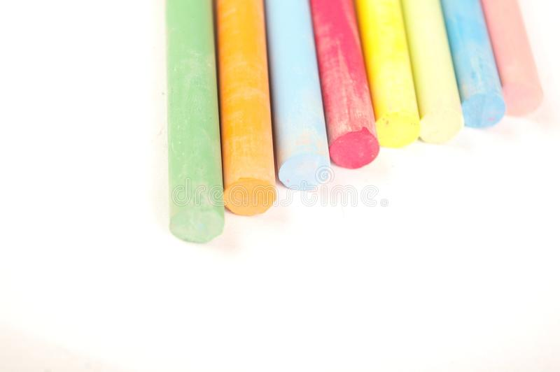 Colour chalk isolated on white royalty free stock images