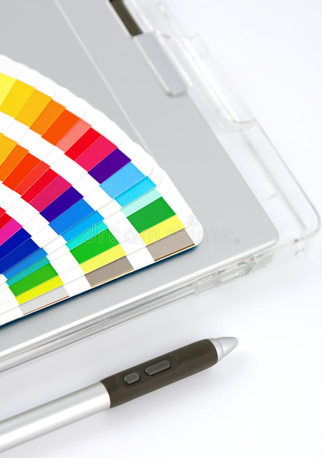 Colour Chart, Graphics Tablet And Pen. Close-up view on white with feint shadow royalty free stock photography