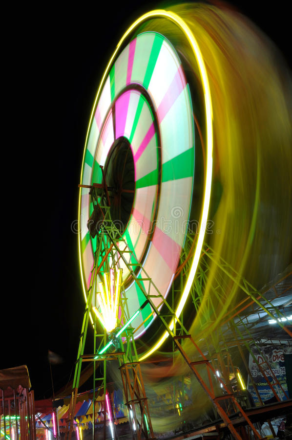 Colour light from Ferris wheel at night royalty free stock photo