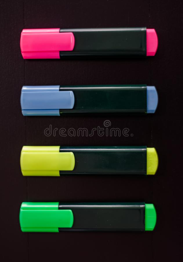 Markers with no logo. Colour markers on wood background with no logo royalty free stock photo