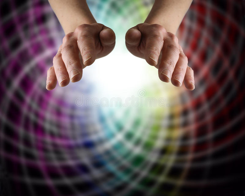 Colour Matrix Healing. Healer's hands with a rainbow matrix background stock images