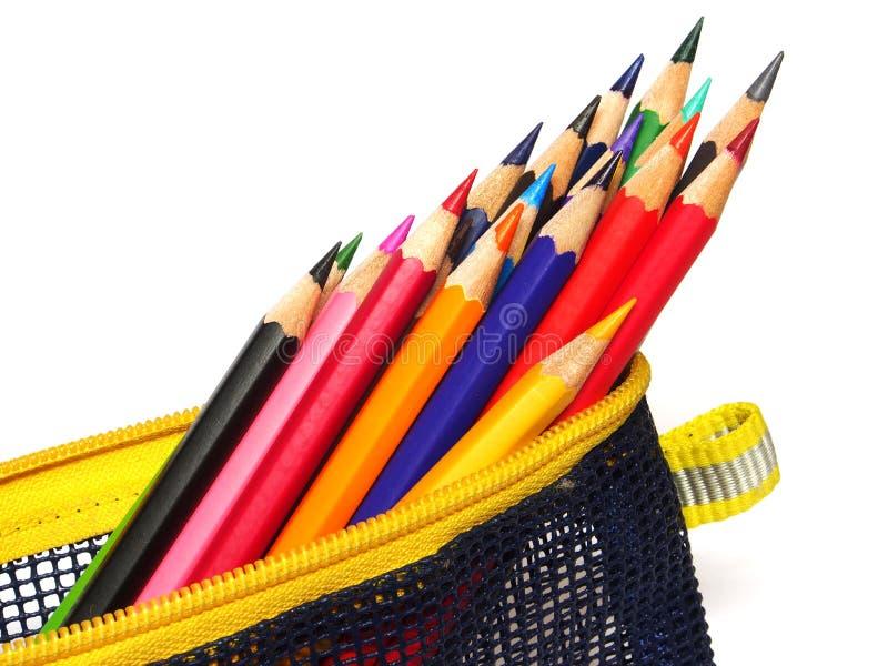 Colour ołówki w torbie odizolowywającej na białym tle zdjęcia stock