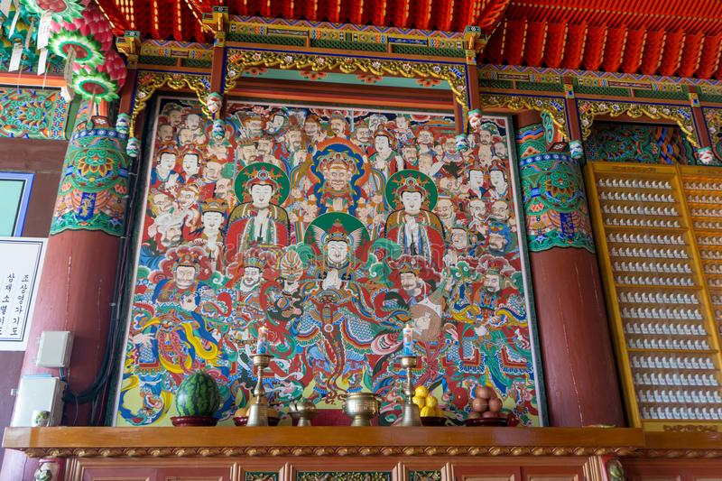 Colour painting of Buddha and buddhism gods images in Main hall of Haedong Yonggungsa Temple. BUSAN, SOUTH KOREA - JULY 20, 2017 : Colour painting of Buddha and royalty free stock image