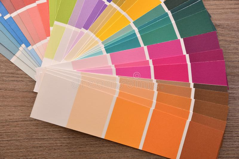 Colour palette in fan on wooden table close up top royalty free stock photography
