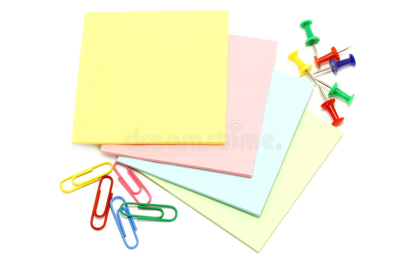 Colour paper with drawing pins and clips royalty free stock images