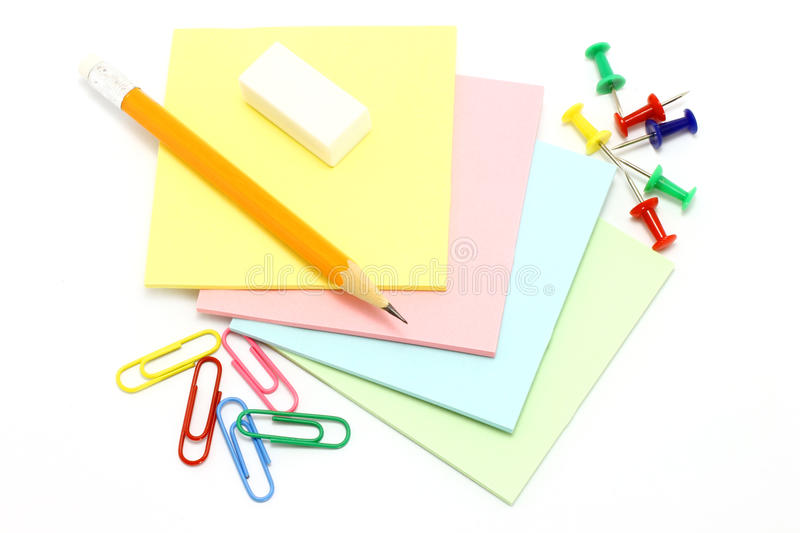 Colour paper with drawing pins and clips and penci royalty free stock image