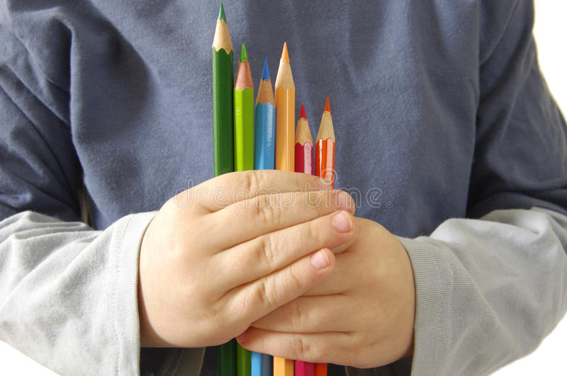 Colour Pencils Ahd Children In Hands Royalty Free Stock Images