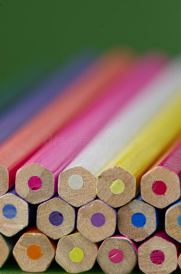 Colour pencils on green background stock photo