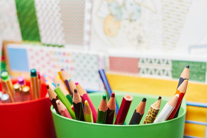 Colour pencils in a green cup stock photography