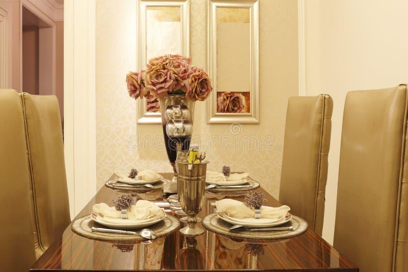 Colour skoczny stół, krzesło, tableware obraz stock