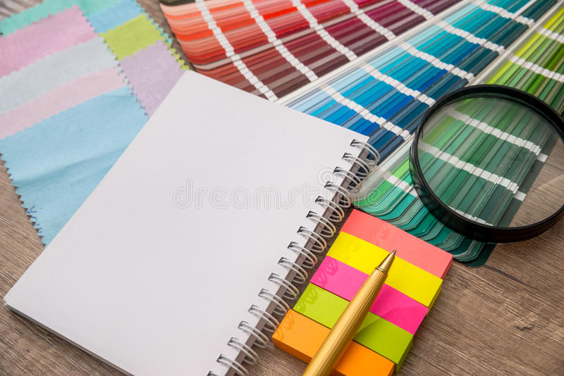 Colour swatches book. With notepad stock photos