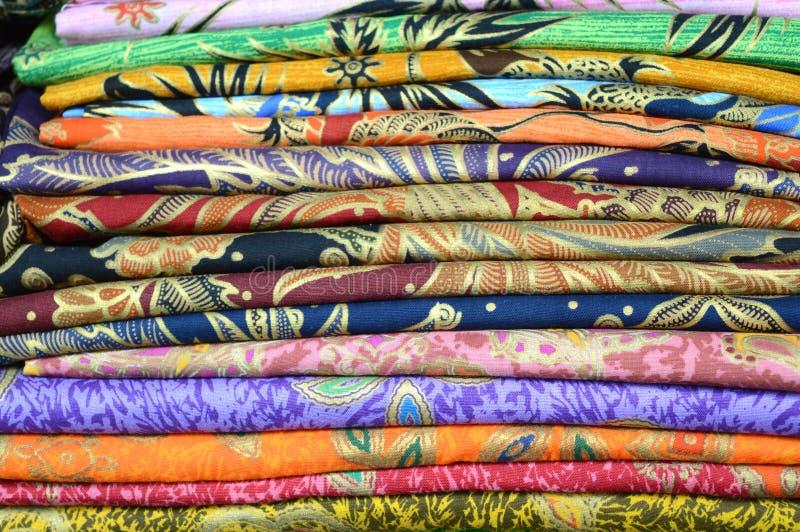 Coloured batik fabrics stock images