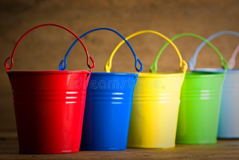 Coloured buckets on the floor