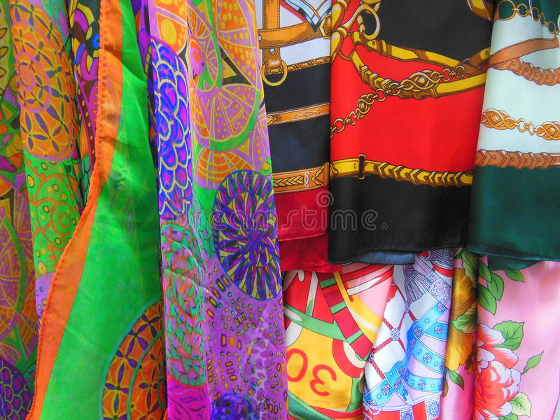 Coloured fabrics for sale stock images