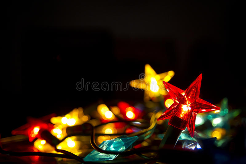Coloured fairy Lights against black royalty free stock images