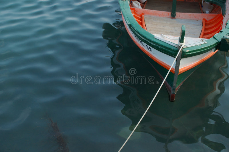A coloured fishing boat. A view of a coloured fishing boat royalty free stock photo