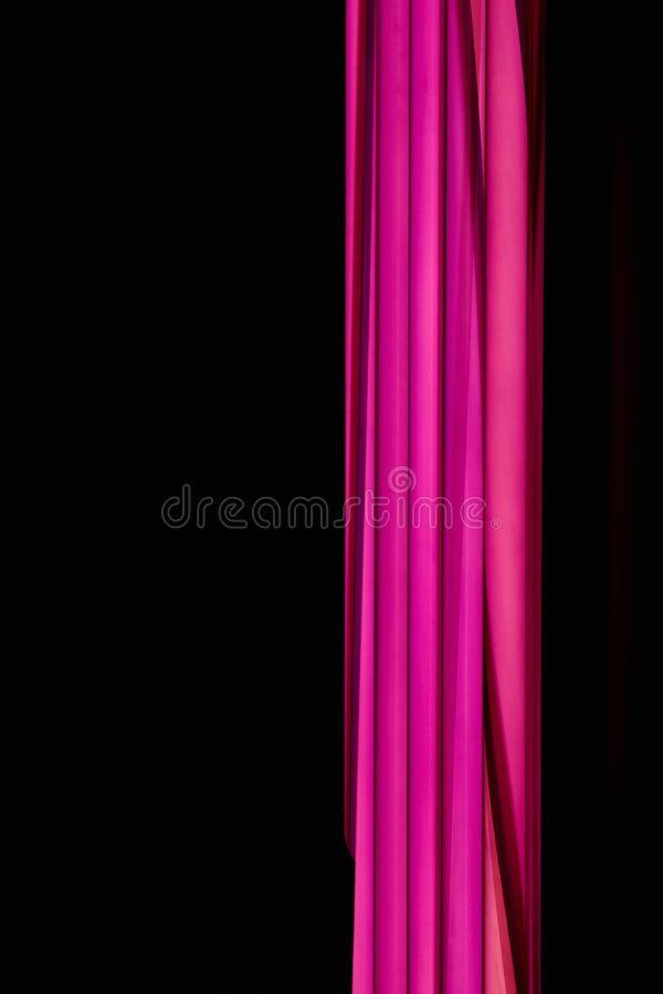 Coloured fluorescent lamp. Pink coloured fluorescent lamp and black background royalty free stock image