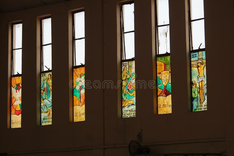 Coloured glass windows in our church stock photography