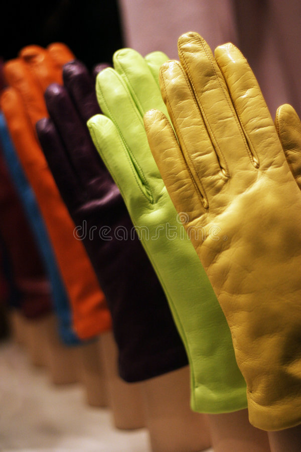 Coloured-gloves. Coloured glows in a shop window stock photos
