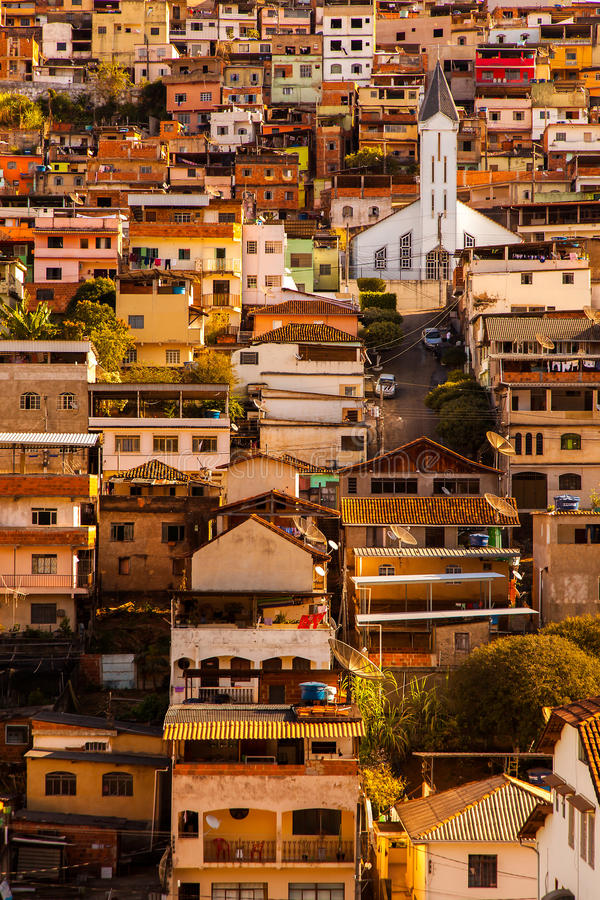 Coloured houses and church in a sloping city in Minas Gerais - Brazil. Coloured houses and church in a sloping city in Minas Gerais, Brazil royalty free stock photo