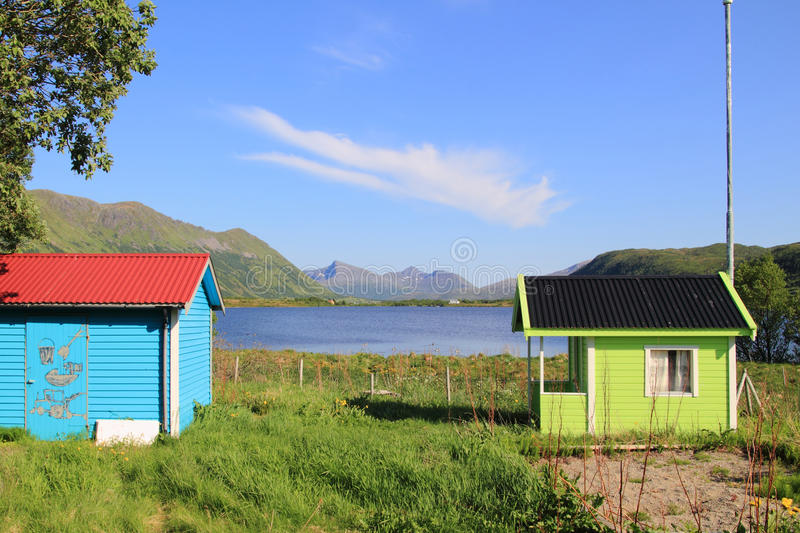 Coloured houses of Kvalnes in Lofoten. Houses of a Kindergarten painted whit flourecet colours royalty free stock photos