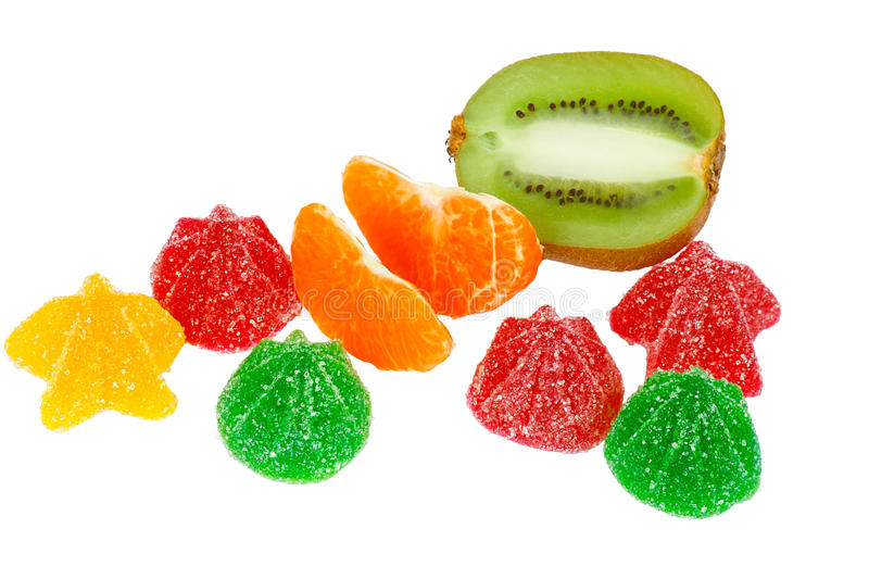 Coloured jelly sweets, kiwi and tangerine royalty free stock image