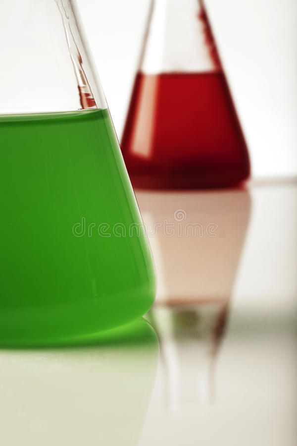 Coloured lab beakers royalty free stock photography