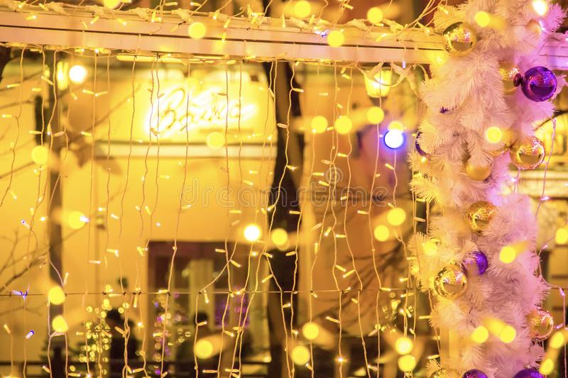 Coloured light bulbs in light tunnel. Christmas street decorations royalty free stock photography