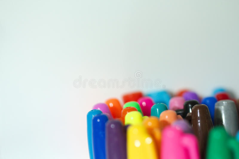 Coloured Marker Pens. In container with white background. Taken with a macro lens stock photos