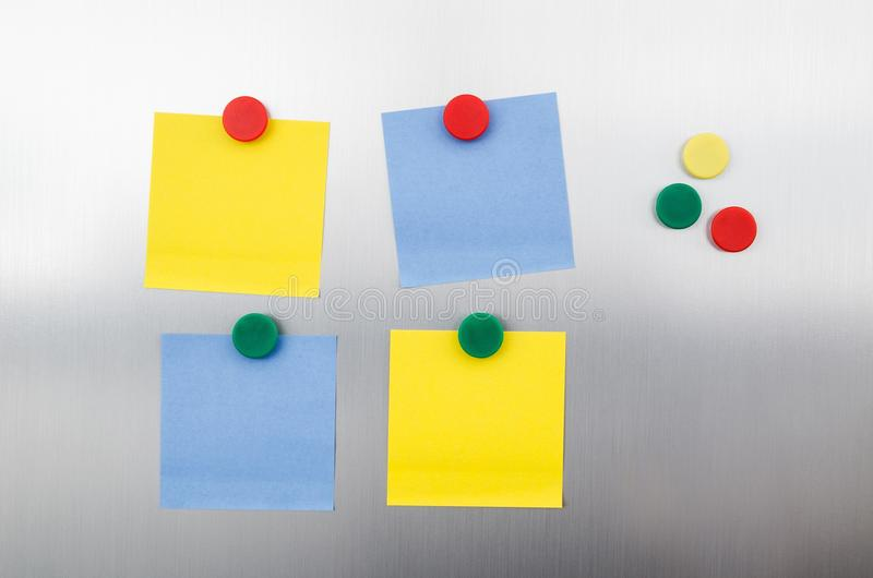 Coloured notes and magnets on fridge royalty free stock photo