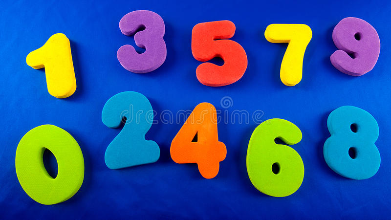 Coloured numbers. A close up of coloured plastic numbers stock photos
