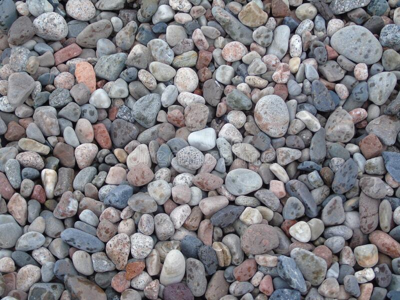 Coloured pebbled beach of Tralee Bay, Oban stock photography