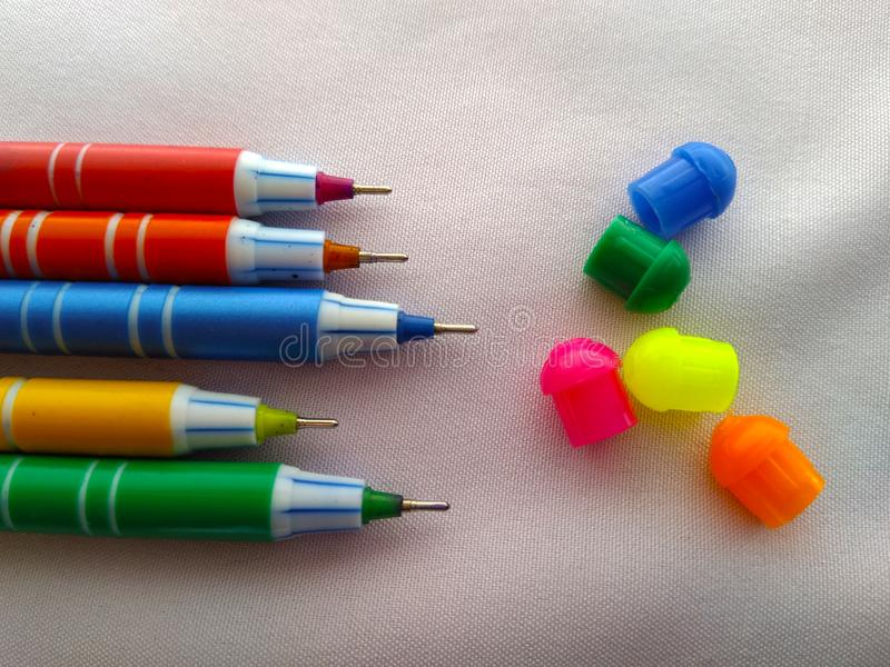 Coloured pen with cap isolated stock photography
