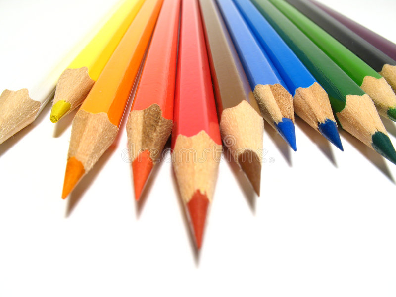 Coloured pencils. Detail of spectrum coloured pencils royalty free stock photography