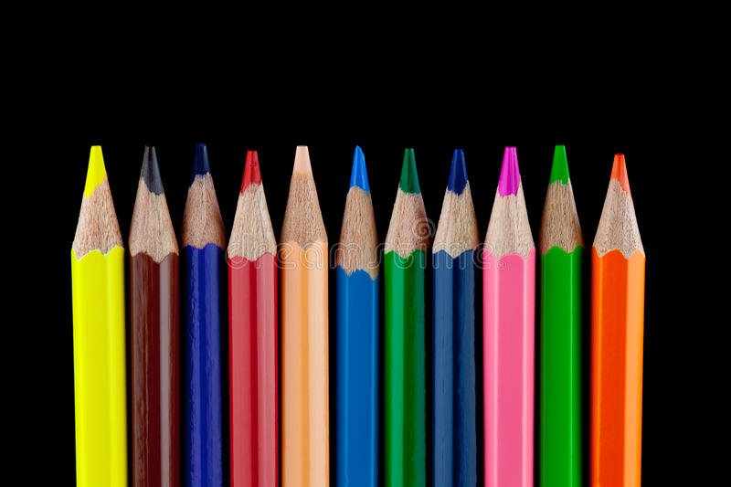Coloured Pencils on Black Background. A set of coloured pencils isolated against a black background royalty free stock photos
