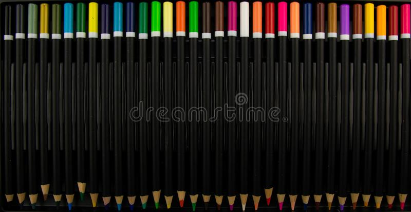 Coloured pencils. Color pencils isolated on black background.Close up. Colorful pencil. Colored pencils background.Pens and pencil royalty free stock image