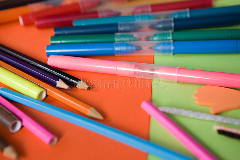 Coloured pencils and felt tip pens royalty free stock photo