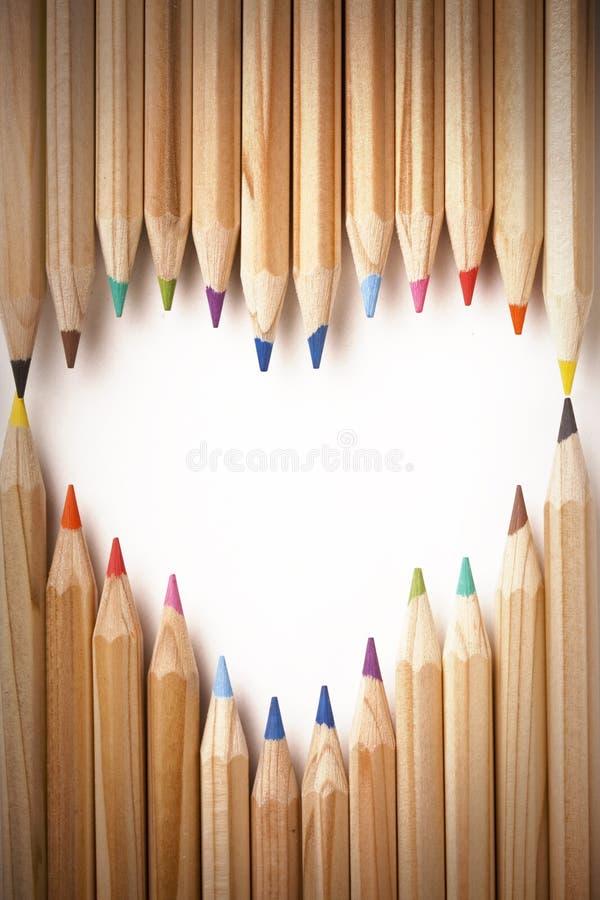Coloured pencils heart shape stock photography