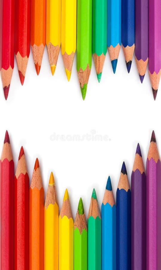 Coloured pencils. Heart shape rainbow colour isolated background royalty free stock photos