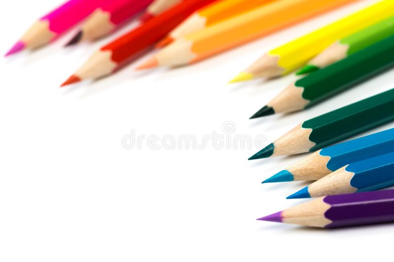 Coloured pencils on isolated white stock image