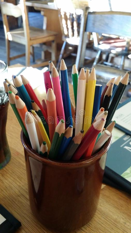 Coloured pencils in a pot royalty free stock photography