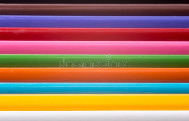Coloured pencils. A ranks of ten coloured pencils stock photos