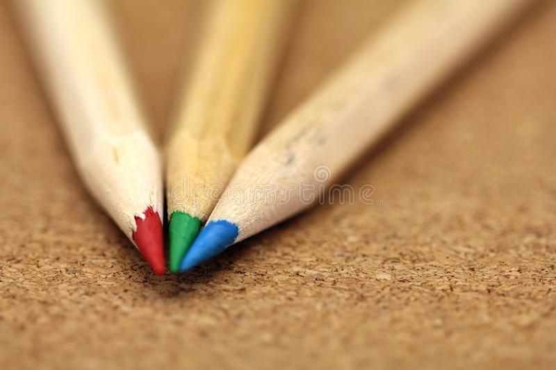 Coloured pencils. Red green & blue stock images