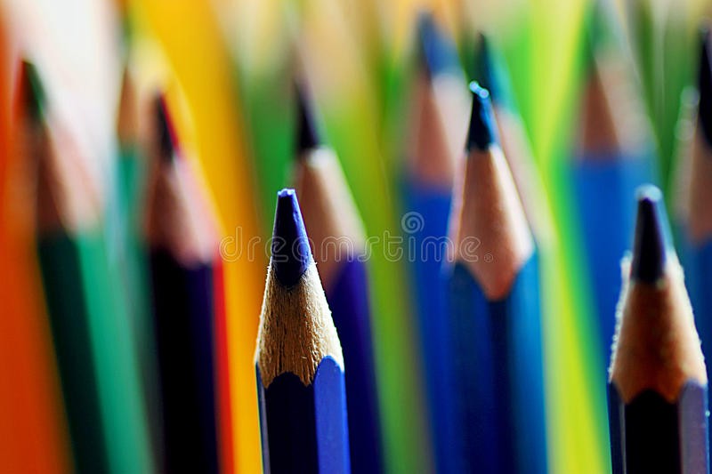 Coloured pencils. In warm and cold color tones royalty free stock photography
