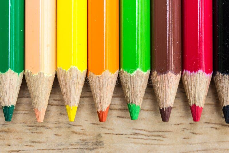 Coloured pencils on wood stock photos