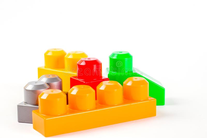 Coloured plastic building blocks. Isolated on white background stock photos